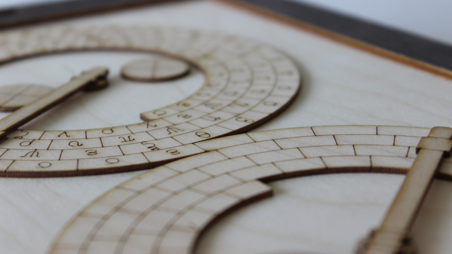 Challenging wooden puzzles that combine to tell a story of heroes, Gods and monsters, based around the Greek Antikythera Mechanism