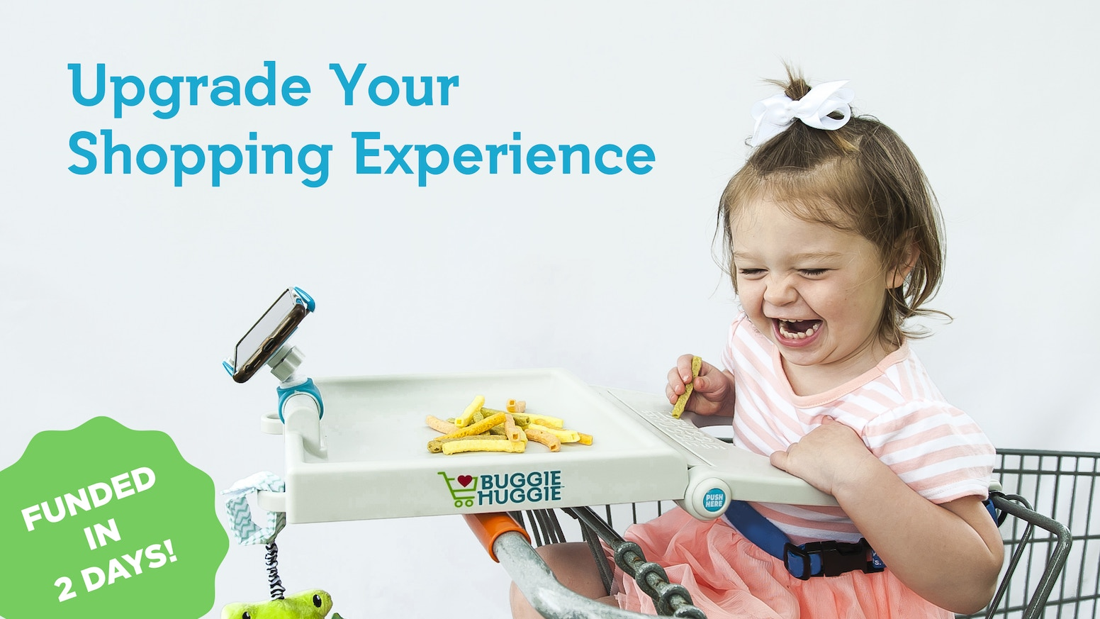 It's like a high-chair tray for your shopping cart that helps secure and entertain your kids while shopping!