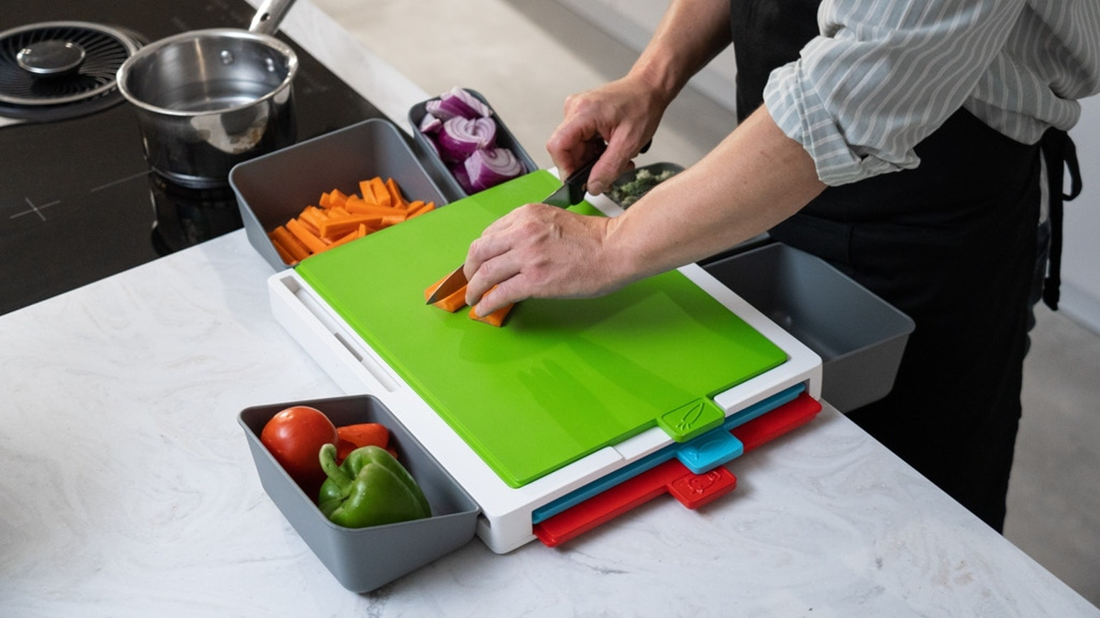 Chopsy is a multi use food preparation station combining chopping boards and pods for easy meal prep and cooking.