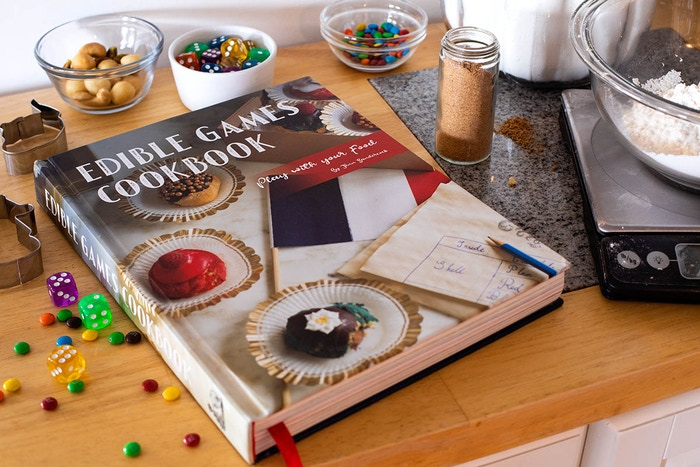 A beautiful cookbook of a dozen tabletop games you really eat!