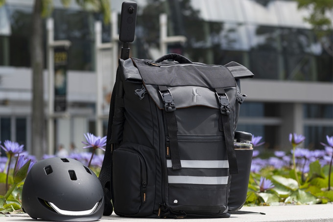 "ATSA Everyday® Skateboard Backpack The ATSA Everyday® Skateboard Backpack is designed to carry any kind of (electric) skateboard together with your everyday essentials.  Built with clever storage solutions for electric skateboard riders: remote controller, charger, shades, water bottle, camera tripod, fullface helmet, a change of fresh clothes/shoes and a strap for selfie sticks so you can film hands-free from a drone perspective. There is even a reinforced area for spare battery packs.  With a premium rubberish coating and waterproof zippers, it's perfect for all weather conditions. The matte black design simply looks great in every situation. Confidently carry the ATSA to both client meetings and weekend road trips. It's not just another bag, the Everyday® ESK8 backpack is made to last.   	Premium rubberish fabric & magnetic clasp  	Korean-made waterproof zippers  	Strong enough for heavy boards  	Extra protective padding for laptop up to 17""  	Clever storage solutions for accesories"