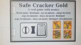 Safe-Cracker-Gold — A dice board game played with money thumbnail